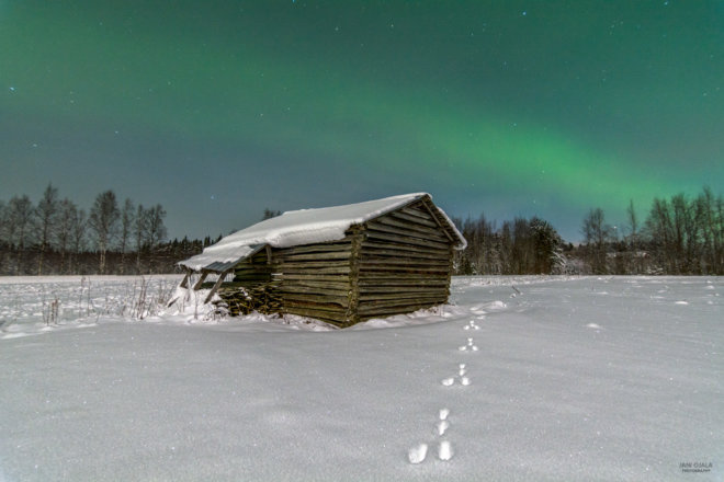 Snow barn with beautiful auroras