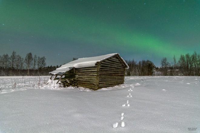Snow barn with beautiful auroras