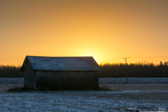 Morning sun behind the barn