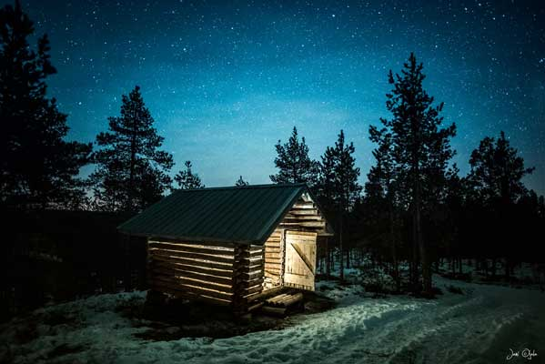 Log barn under the stars